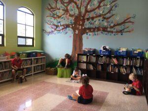 CRIA kids in school library